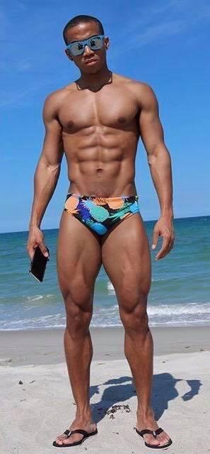 beautiful black men athletic black men melanin muscle flip flops mens eyewear cuteguys sexymen beach body abs speedos hommes noirs hombres negros blue sky beach waves