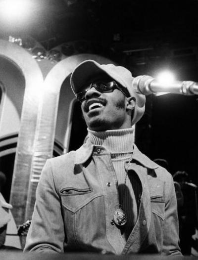"vintageblackglamour:  Happy Birthday to ya Stevie Wonder!!! My favorite musical genius was born 63 years ago today as Steveland Hardaway Judkins (his last name was later changed to Morris) in Saginaw, Michigan. In this 1974 photo, he is performing his classic ""Living For The City"" on ""Top Of The Pops"" in London. Photo: David Warner Ellis/Redferns. In the comment section, let me know what your favorite Stevie song is (Is it possible to have just one?)"