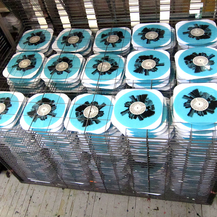 Printing on the uncut B side of 500 blue vinyl records
