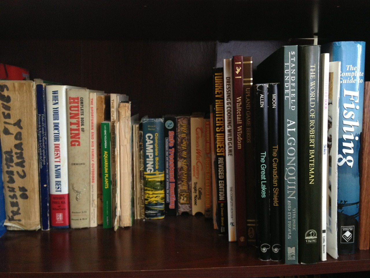 patsyclash:  Nature & wildlife books in bob's bookshelf.