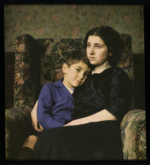 Woman and boy sitting in chair by George Eastman House on Flickr.