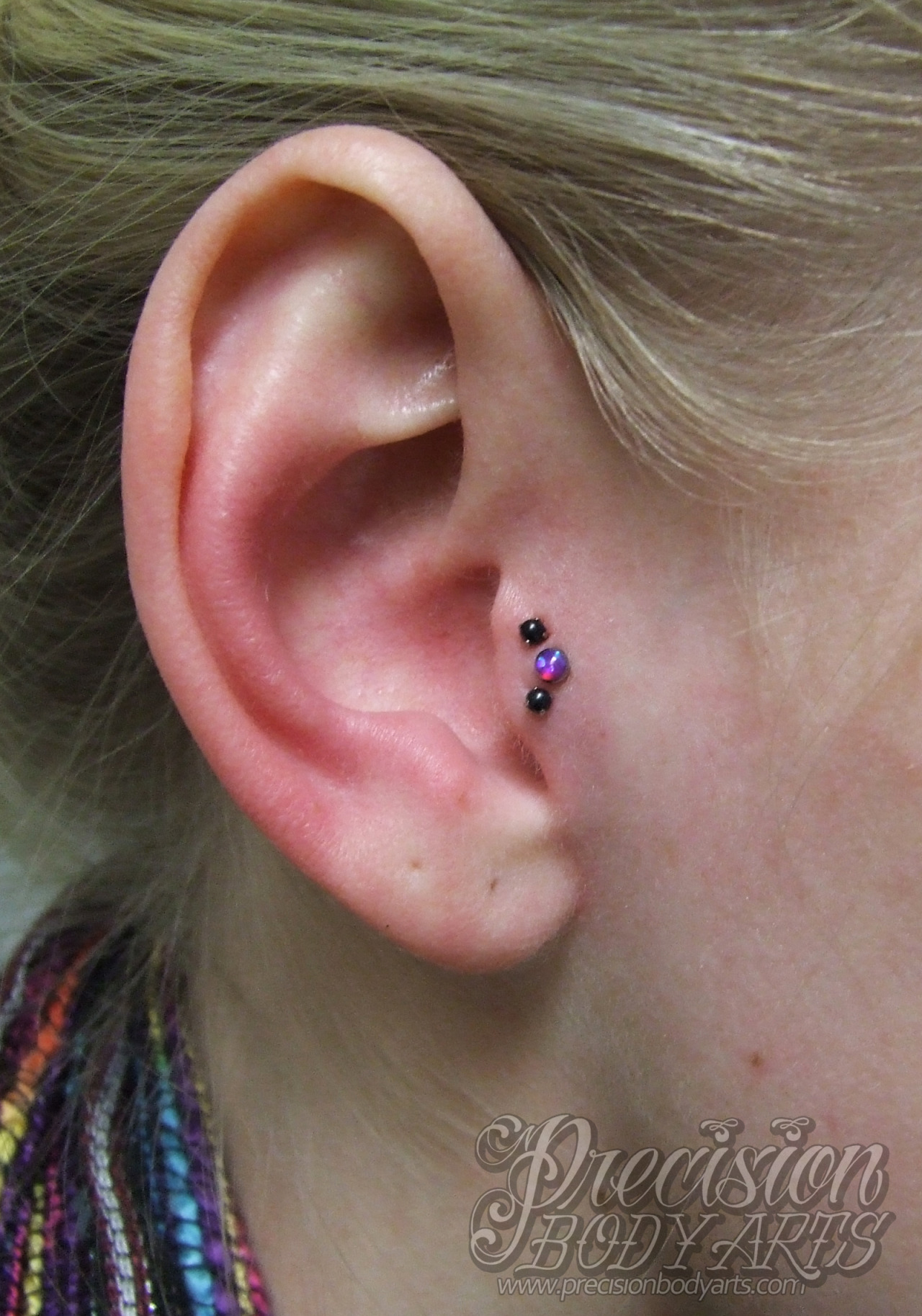 Triple tragus piercing by Ryan Ouellette. Precision Body Arts in Nashua, New Hampshire. Jewelry by Neometal.