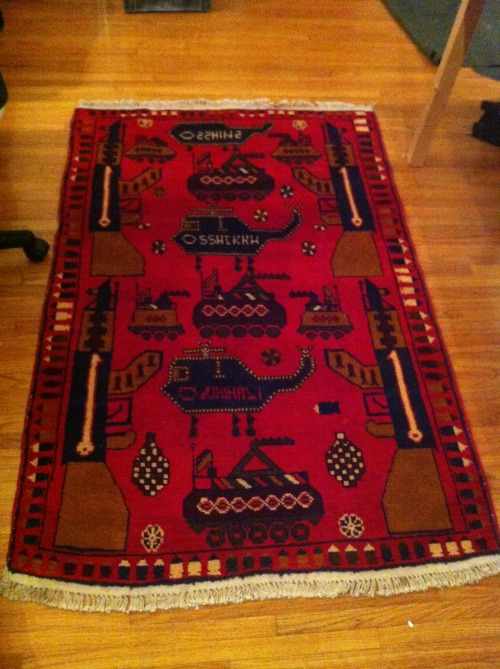 I have wanted an Afghan war rug for years. They were made in the 80s when the Afghans were fighting the Soviets. They've become rare, especially the red ones. I finally found this one for a ridiculous price and I swooped. The design elements of the rugs vary but this one has it all and is in pristine condition. AK-47s, tanks, helicopters, grenades and a border of bullets.