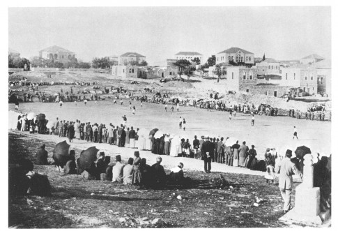A soccer match in the Palestinian quarter of Bab al-Zahirah (Herod's Gate), outside the Old City walls to the northeast - perhaps the earliest photograph of a sports event in Jerusalem. Note the Muslim tomb in the foreground, extreme right.(from Institute for Palestine Studies, Photograph Collection/ 1876-1918) .