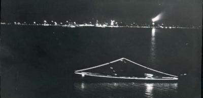 Night cruise, 1959, Chicago. Looking west from the lake, to the right the Lindbergh Beacon atop the Palmolive Building burning bright.
