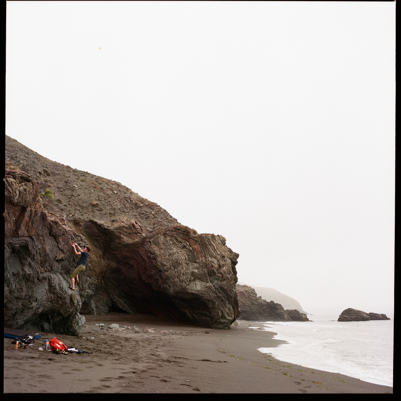 Nick Fisher bouldering at Black Sand Beach. Marin, CA | 2013