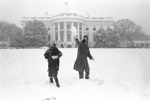 ourpresidents:  Snowball fight at the White House Lynda Johnson and friend Warrie Lynn Smith throw snowballs on the White House Lawn.  2/11/1964. -from the LBJ Library Stay safe and have fun in the snow this weekend!