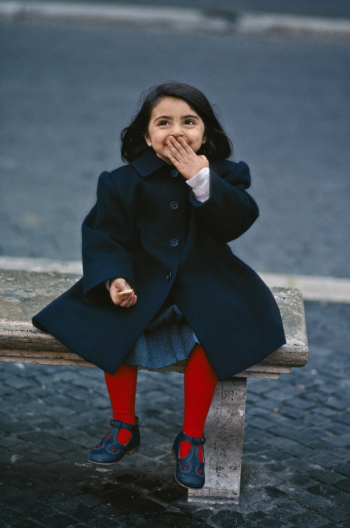 stevemccurrystudios:  Today's photo is of a little girl laughing at St. Paul's Basilica, Rome, Italy.