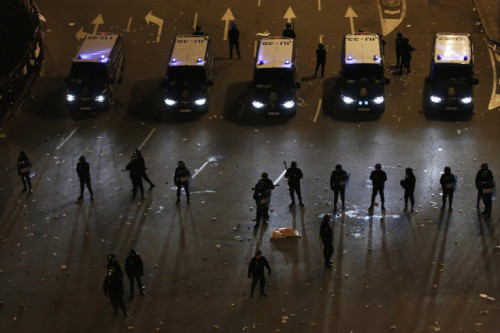 Juan Medina—Reuters  Feb. 23, 2013. Riot police stand in line during a protest against austerity, near the parliament in Madrid, Spain. Read more: http://lightbox.time.com/2013/03/01/pictures-of-the-week-february-22-march-1/#ixzz2MRCN7jC7