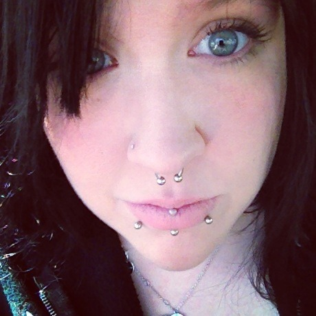 "Katt Carpenter  22 Central New York Shown: 14g septum, 16g snake bites, 14g inverted lebret, 18g nose stud. Not shown: 12g tongue, 5/8"" ears Retired: left & right industrials, eye brow."