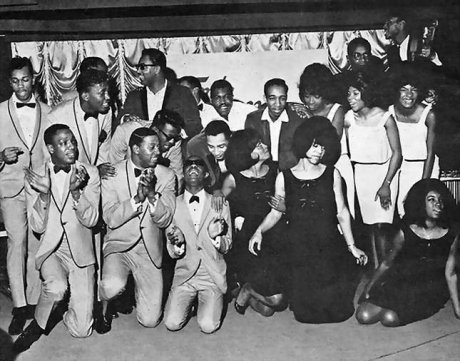 "A METRIC TON OF MOTOWN This is a press pic of the '62-63 ""Motortown revue"" lineup. The sheer #PEAKness is still being debated as I'm still working out who's in the picture. (Feel free to reply with your guesses/confirmations) CONFIRMED: Little Stevie Wonder (if you can't tell which one he is, leave this blog and never return) The Supremes (black dresses up front) Martha and the Vandellas (white dresses behind them) Smokey and the Miracles (Smokey is checking on Stevie) Barrett Strong (the one Diana Ross is looking up at) SUSPECTED, BUT NOT CONFIRMED The Temptations (bottom left. I'm not sure if this is the BIG 5 era Temps, even though dude in the glasses looking down at Stevie kinda looks like David Ruffin.) NO CLUE  Everyone in the back. Who's ready for the first-ever #PEAK BLACKNESS ""Spot the legendary Black musician""-off? Ernest"