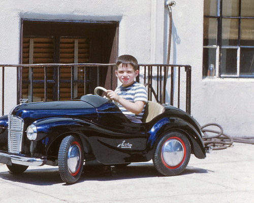 Young motorist in an Austin pedal car, c. 1949 This kid had the best toys. Check out his Schwinn bike via Shorpy