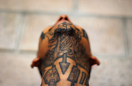 El Salvador: A member of the Mara 18 street gang poses for a photograph in the Izalco jail Photograph: Ulises Rodriguez/Reuters
