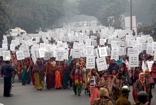 guardian:  Powerful image from New Delhi, India: Hundreds of Indian women and men participate in a peace march to pay homage to the gang rape victim and for women's safety Photograph: Anindito Mukherjee/EPA