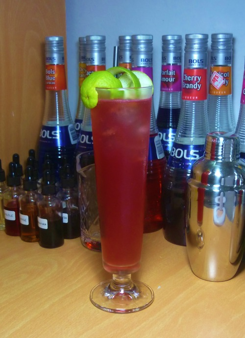 Oahu Gin Sling Gin - 2 oz Lime Juice - 1 oz Crème de Cassis - 1/2 oz Bénédictine - 1/2 oz Simple Syrup - 1 tsp Soda Water - 3 oz Shake everything except soda with ice and pour into a pilsner glass. Add more ice to fill if necessary. Garnish with a lime spiral. Created by Thomas Mario, food and drink editor of Playboy magazine, circa 1970. The style of mixed drinks known as the Slings had gone through many changes through the centuries. It went from something that's made of three essential ingredients (spirit, sugar and water) to complex versions such as this, containing citrus juice and sometimes even spices. Let's face it, the classic Slings are perhaps too simple to survive the test of time, it needed to evolve to suit people's changing palate. The Gin Sling today is nothing more than a Collins, lime or lemon juice became one of the major ingredients; water used to cut down the strength is replaced by carbonated water; and various liqueurs are used to sweeten it, some fruity, some herbal. The Oahu Gin Sling, despite the fact that it's hardly a real Sling, is quite delicious nevertheless. Following the recipe above, you'll get a drink that's slightly too sweet for my taste, omitting the extra sugar syrup should help; despite the acid inside soda water can reduce the sweetness to a certain point, bear in mind lime juice is far from sour enough to balance out the liqueurs (as lemon juice would). The garnish is suppose to look like a horse's neck. Cut a long, continuous strip of lime peel from top to bottom. Place the peel inside the glass, hooking one end to the rim. Limes are not as big as lemons, therefore it's hard to achieve the same result as you would in a Horse's Neck cocktail, especially when this is served in a tall pilsner glass.