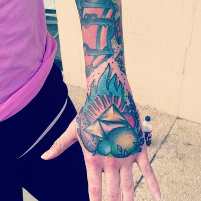 This is my Legend of Zelda hand piece done by Christopher Cain at Supreme Ink in Lexington, SC. It ties in with my Legend of Zelda half-sleeve, which can be viewed from my blog. This specific piece features the Triforce, a fairy ocarina, three color orbs representing each goddess, and the pesky blue fire! stockpotinn.tumblr.com