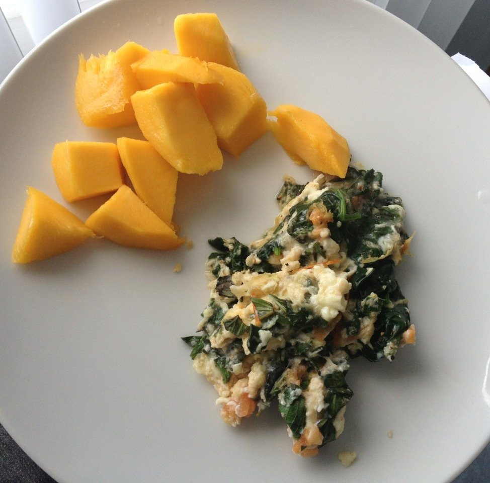 Late breakfast post: mango and an egg white omelette with spinach, tomatoes, basil, and lite mozzarella (168 cals)