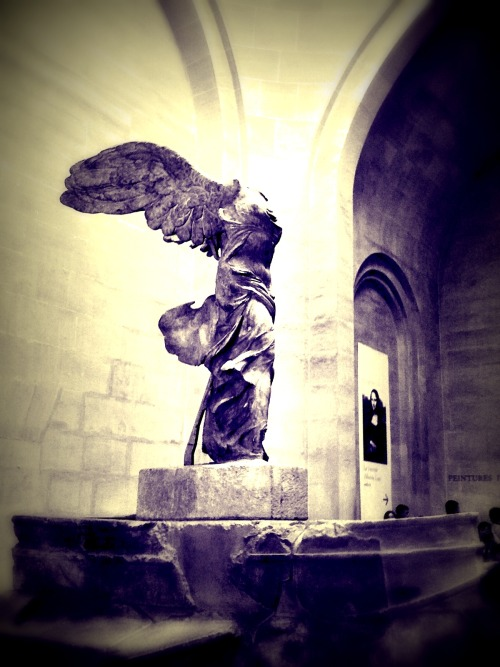 Winged Victory of Samothrace   Back from a bit of a break from blogging, decided to put it aside while I focused on school.    I recently dropped my old iPhone 3G for the thousandth time and finally cracked the screen so I picked up a new SIII. I was going through the old photos on there and doing some interesting but simple editing in Picasa.    This is a mobile shot I took of the Winged Victory of Samothrace, also referred to as Nike of Samothrace, at the Louvre Museum in Paris, France.    It is a 2nd century BC marble sculpture of the Greek goddess Nike (Victory). Since 1884, it has been prominently displayed at the Louvre.    The Nike of Samothrace, discovered in 1863 on the island of Samothrace (in Greek, Σαμοθρακη — Samothraki), is estimated to have been created around 190 BC. It was created to not only honor the goddess, Nike, but to honor a sea battle. It conveys a sense of action and triumph as well as portraying artful flowing drapery through its features which the Greeks considered ideal beauty.    The sculptor is unknown.     Follow Highly Defined Reality on Facebook