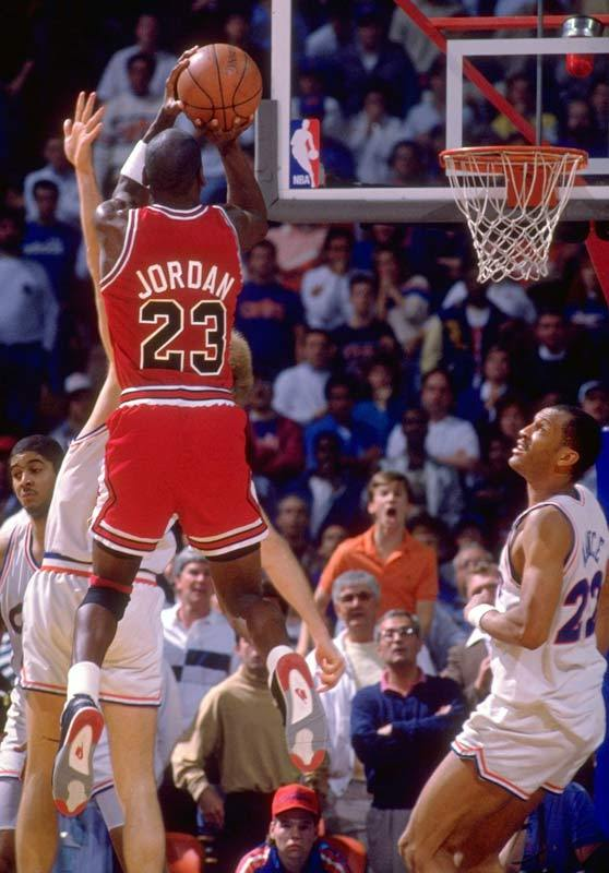 Michael Jordan rises up for a buzzer-beater to defeat the Cleveland Cavaliers in the 1989 playoffs. Jordan hit a jumper with six seconds remaining to give the Bulls a lead, only for the Cavaliers to take it right back with a layup by Craig Ehlo with three seconds left. Jordan, double-teamed on the inbounds play, got just enough separation to receive the ball and get the shot off over Ehlo to win the first-round series in five games. (Manny Millan/SI) GALLERY: SI's 100 Best Michael Jordan Photos