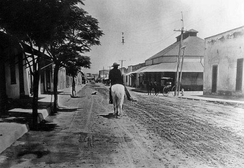 whitedogblog:  Lone horseman riding through Tucson, 1880