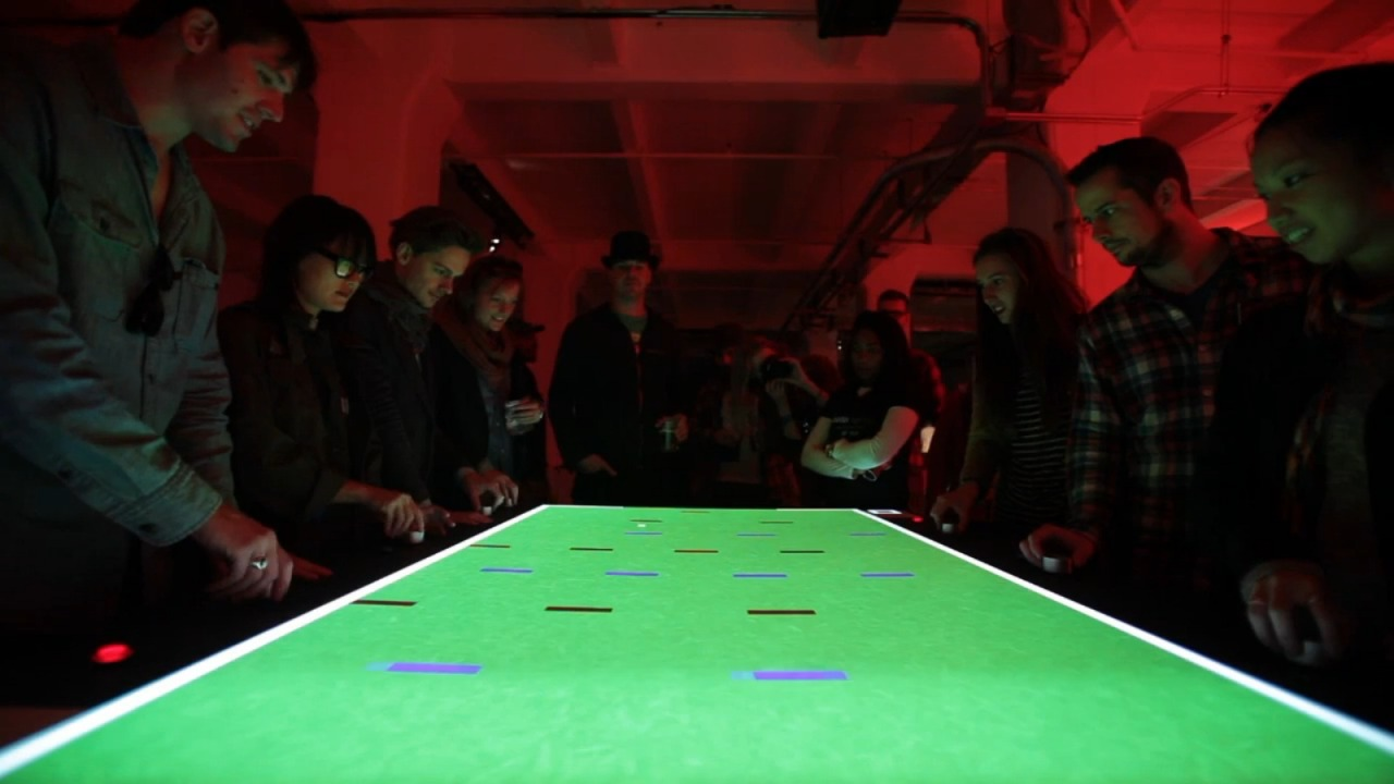 Pong is Reborn with 8-Person Multiplayer Art group SuperUber, which seeks to combine technology and art, rolled out a new exhibit which focuses on the simplicity of Pong matched with the joy and interaction of multiplayer. Superpong gives each player a dial which controls a row of paddles. The ball then travels between the rows. This is fairly simple but would obviously get pretty competitive. This raises an interesting question. With the resurgence of popular retro games and the growth of arcade-style bars, could we see a rebirth of the arcade scene based around simple game concepts that focus on interaction? Watch the game in action:  SuperPong from Lucas Werthein on Vimeo. Check It: More Gaming From AlbotasBuy It: Extra Lives: Why Video Games Matter
