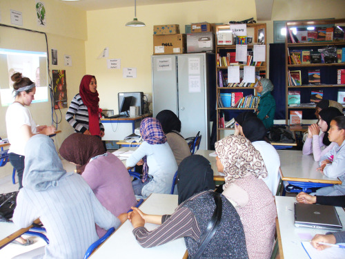 Peace Corps Volunteers in Morocco recently hosted an HIV/AIDS awareness session for 60 girl students at a local high school in Tarmikt. Aside from info presentations and an awesome jeopardy game led by Peace Corps Volunteer Sairah Jahangir, the attendees also had a Skype session with two female HIV/AIDS patients from Washington, D.C.  Moroccan counterpart Fatiha Haouat translated questions written by students who wanted to know things like what it's like being HIV-positive, how the women found out their status, and what their lives are like with the disease. For all of the students it was the first time they had ever met an actual person living with HIV, nonetheless had the opportunity to talk frankly about what living with the disease is like. Perhaps it was one of the first times HIV-positive women have ever had a platform in Morocco to speak publicly about their status and be unashamed. Michelle and Charlene, the two women interviewed, did an amazing job sharing their life stories and helped to change many perspectives on the stigma of the disease, especially as it affects women.  The resounding message was that HIV is like any other disease and that they lead very normal lives. They advocated inclusion and support of women living with HIV, and also helped promote a safe sex message among students. It was a moving interview that called into question ideas of victimhood in Morocco, and how blaming the victim is a kind of injustice: Charlene became HIV-positive when she was raped at the age of 8, an incident that also left her pregnant. Charlene is a practicing Sunni Muslim who is now a resident at N Street Village, the organization that facilitated the interview. The Volunteers who led the session said it was incredible to see the faces of these two women projected on the schoolroom wall, to hear their actual voices speaking truth to stigma in a country where HIV patients cannot speak out for fear of persecution.