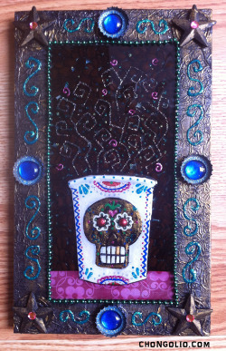 """Java Beans"" Mixed media in an embellished altered frame. This one has it all; metallic and acrylic paint, sculpted plasticine clay, foil, sparkly bumpy paint, bottle caps, two part resin, paper scraps, glass and plastic beads, rhinestones and even coffee beans…Imagine that!"