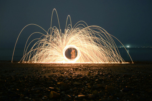 50daylight:  We got aircraft cable, a whisk and some steel wool, lit it on fire and spun it around on foggy Kits beach in Vancouver. New Years Eve done right! Camera settings: Nikon D3100, Shutter: 10s, F/3.5, 100ISO