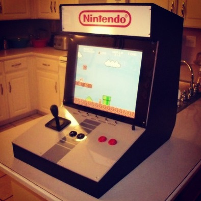 retrogamingblog:  NES Arcade Console Built into a Kitchen Countertop  As nice as this is, most NES games weren't really built for arcade controls. They feel off.