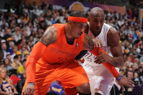 nba:  Carmelo Anthony of the New York Knicks and Kobe Bryant of the Los Angeles Lakers battle for positioning at Staples Center on December 25, 2012 in Los Angeles, California. (Photo by Andrew D. Bernstein/NBAE via Getty Images)