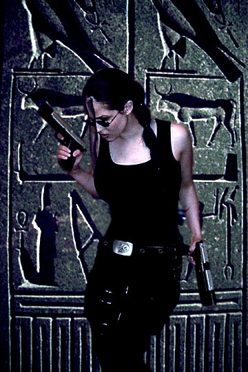 "tombraider:  Croft Couture #22: Aleena  The Tomb Raider fandom is full of talented artists, entertainers, and perhaps most notably, phenomenal cosplay talent. ""Croft Couture"" aims to showcase these lovely and dedicated women, and give Lara costumers a spot to share their experiences while dressed as gaming's leading lady.  While Aleena started out dressing as Lara for fun, she found her calling as a seamstress as a direct result of her costumed capers. Make sure to check out Aleena's DeviantArt gallery for a slew of impressive props and costumes she's made for other Lara fans throughout the years! Fast Stats  Name: Aleena Averly Country: USA Occupation: Seamstress/Model Fan Since: 1999 Favorite Tomb Raider Game: Tie between TRL, Legend, and Underworld Favorite Non-Lara Tomb Raider Character: Alister & Zip Favorite Tomb Raider Villain: Octopus from Underworld! Number of Lara Croft Costumes: 8  First Lara Croft Cosplay: Movie Lara Favorite Lara Croft Cosplay: Movie Lara or Biker from Legend Future Lara Croft Cosplay: Original                                                         DeviantArt  Q&A What first drew you to the Tomb Raider franchise, and what initially inspired you to cosplay as Lara Croft?  I was given the game Tomb Raider: The Last Revelation in December of 1999 for my birthday. I couldn't put it down! I loved the gameplay, the characters, and the puzzles. The places Lara visited really drew you into the game along with the sound effects in the background. I dressed up in the movie outfit just before the movie was released for a Halloween party and was hired to do photos for a gun replica by Shorty USA, an airsoft company. From there I wanted accurate gear and outfits so I was hooked!  What Lara Croft costume did you tackle first?  The movie outfit!  What is your favorite Lara Croft ensemble?  I am so partial to the movie outfit since it was my first, but there are a lot of outfits from Legend that are just plain fun and the Underworld gun belt rig and backpack are by far my favorite of her gear.  What Croft costumes are still on your roster?  The original aviator jacket she wears along with an updated biker jacket.  Which Lara costume was the most difficult to construct? Was it due to a particular garment or prop?  The Underworld backpack! It was literally the bane of my existence! Normally it takes me only an hour or so to make a pattern for something. That backpack in particular took months to make, going through 7 variations until I was finally happy!  Lara Croft's lifestyle is full of intrigue and adventure. Do you have any memorable photoshoots or convention appearances that pay tribute to Lara's lifestyle?  I don't have any convention appearances under my belt, but I was lucky enough to live in Europe as a young teen. I hadn't started cosplaying as Lara while I lived there sadly, but was regularly traveling to dig sites and ruins in Europe in my real life. I think that my love for it was why the game drew me in so easily.  Along the same lines, what's the most exotic location you've traveled to?  Pompeii in Italy was amazing because until you go there, you don't realize how large it is and that everything is still preserved!  What about Lara's physical strength or mental prowess most inspires you? Has this, or your desire to cosplay Lara, influenced your daily life?  Back when I started cosplaying we were all called look-a-likes. We had not heard of the term ""cosplay"" and it was not a popular thing to do. Many people viewed us all as ""weird"" or attention seekers. It wasn't ""hot"" to be the nerd or gamer girl back then and was far less common. I'm proud to be part of a past that just doesn't exist the same anymore. Being ""that girl"" really forced me to grow up and not care what others thought, which as an adult has translated into more confidence and the willingness to take risks that had I grown up any other way, may have been far more intimidating or even out of my reach. Working on the belts and outfits encouraged me to learn new skills and really push myself to figure them out properly, which later in life gave me the ability to open my own business a few years back sewing wedding gowns and corsets for clients. In the past year I have been beyond lucky enough to start my path back to Lara and get into replica items. It's something I am passionate about and am grateful everyday I have such a fun job."
