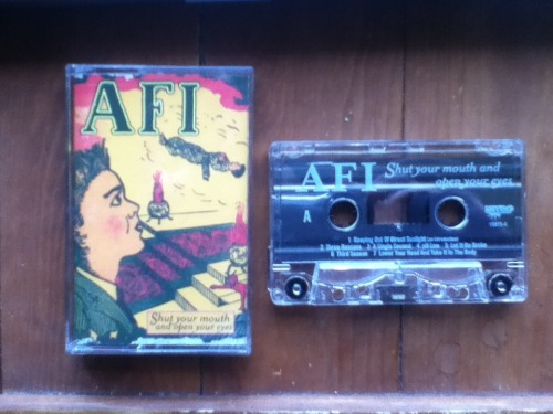 tapeage:  Day 47 - AFI - Shut Your Mouth And Open Your Eyes Seriously, THE best AFI record. AFI is an interesting band, and their albums can be put into 3 catagories: Mid-90's Skate Punk, Late-90's gothic/horror punk, and 2003-present Hot Topic AFI. Suprisingly with that, they'e been able to keep a growing fanbase, even though evry album they've made has been a big step away from their previous. Shut your mouth… was in that mid-period between Very proud of ya, and black sails, so it has a very unique sound. That may be a reason why I like it so much, its so unique for a punk record. It's super heavy, sometimes cross-over, yet melodic like the albums before and after it. I only wish they released more material that sounded like this.