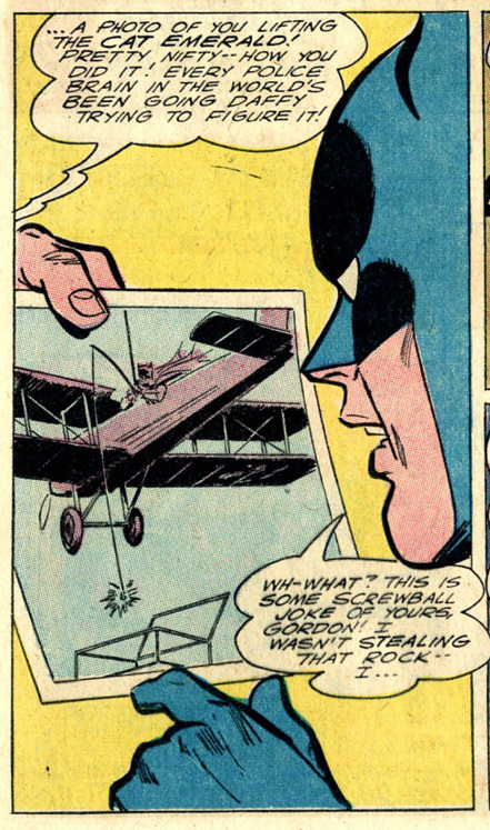 Batman, fishing for emeralds from a biplane