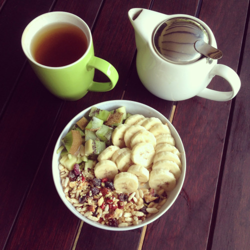 cleanbodyfreshstart:  Late breakfast with brewed green tea, making today start positively.   Big bowl of mixed seeds (poppy, sesame, chia, sunflower, pumpkin), amaranth, buckwheat, puffed rice, millet, cranberries, goji berries, sultanas, banana, kiwi, granny smith apple, soy milk, cinnamon and agave nectar.
