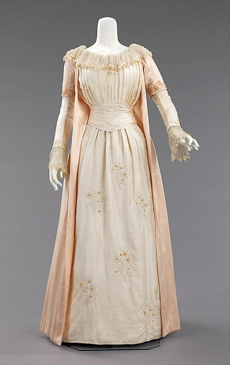 "omgthatdress:  Tea Gown Liberty & Co., 1885 The Metropolitan Museum of Art ""Artistic dress had its roots in mid-Victorian England, where Pre-Raphaelite artists, with their love of things medieval, and disdain of industrialized society, revived a version of the loose fitting, relatively plain gowns of that time. Its successor, Aesthetic dress, drew from the same design, but not philosophical, resources. In 1884, Liberty & Co. hired Edward William Godwin, an architect and proponent of Aesthetic dress and dress reform, to head their new costume department. This tea gown, with its light corseting and bustle is a more fashionable adaptation of the Aesthetic style. An unusually early, and quite beautiful, example of Liberty clothing, it is executed in the company's distinctive light and supple silks. With its simple adornment and pale colors, it stands in marked contrast to the heavily embellished, confining, vividly colored costumes of the day. This style of dress became particularly popular as at-home wear because it was both comfortable and appropriate for greeting visitors."""