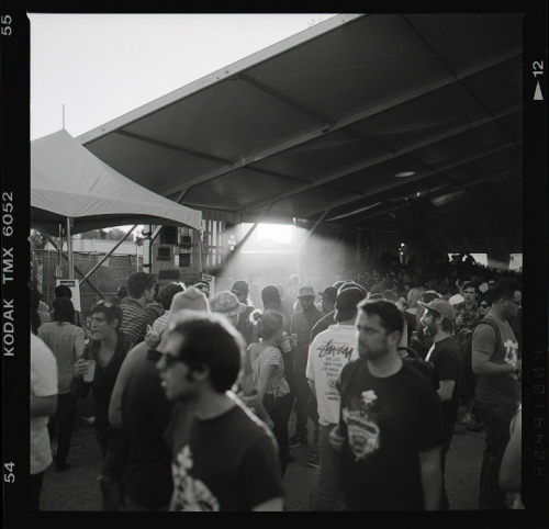 Sunshine, dust, and young people drinking beer. Austin, TX.