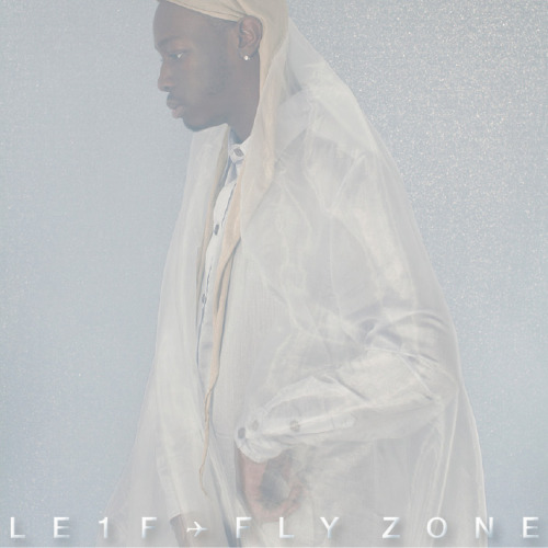 "FY!QM Reviews-Le1f's Fly Zone Mixtape Once again I am late to the party. Le1f released a new mixtape a couple months back and it flew (please excuse the unintentional pun) right over my head. But no matter, because regardless of my lateness, Fly Zone is pretty stellar. Chances are you've already heard of Le1f. His Dark York mixtape received a bunch of critical acclaim last year, and his video for ""Wut"" featured Le1f miming a Kamehameha from Dragon Ball Z and a shirtless man in a Pikachu mask. He was also featured in a widely circulated Pitchfork article about gay NYC area rappers and MCs.  While Dark York was hyperactive and abrasive, all sharp, staccato beats and ear splitting synths/programming in that way that has really caught on with some rappers over the past few years (a sound I like to call The Internet), Fly Zone is toned down to the best effect. The programming is practically mellow by comparison to his earlier work and that of his contemporaries. Tracks like ""Autopilot"" and ""PsyLock"" are reminiscent of Frank Ocean, very chill and sexy (especially on ""Psylock,"" although it is about cyber sex, so mission accomplished on that one). Tempos are slowed, there's a lot of reverb all over the place, and the number of pieces to each song are much fewer, which allows Le1f's voice to provide a lot of the depth and harshness to the album. Le1f is undoubtedly the star of the show, front and center, whereas on previous efforts, he could at times be overshadowed by his beats. There are a few fast, club ready tracks like ""Airbending"" and ""Spa Day."" The former is pretty much just a minimalist beat and Le1f, with a few synth flourishes, but Le1f and producer LOLGurlz show how talented they are by creating an amazing sense of urgency and danceability.  Like I said above, Le1f is front and center. This is his mixtape. His voice provides an excellent contrast to the thin, trebely synths are sharp beats without a whole lot of bass. Le1f is the low end through much of the album with a deep voice and a cutting delivery, taking on everyone and doing it with style. Le1f is awesome, and is getting some well deserved recognition. Fly Zone is his best material to date, and I can only seem him getting better. Fly Zone can be found at Le1f's soundcloud."