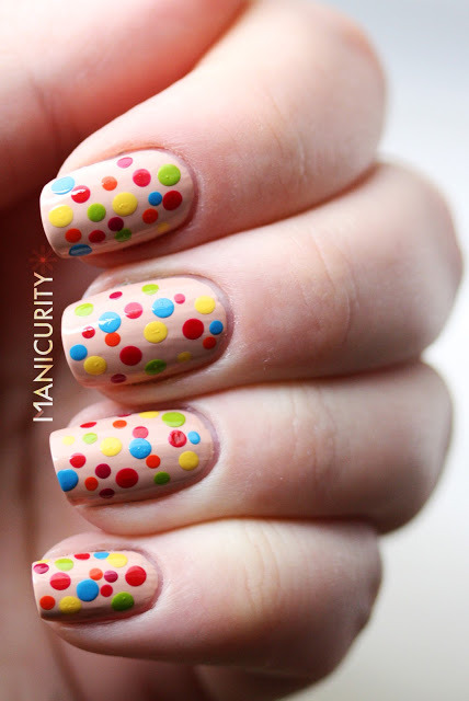 manicurity:  Rainbow-Polka-Dotticure | Click through for more info + photos - http://bit.ly/XBOiZY