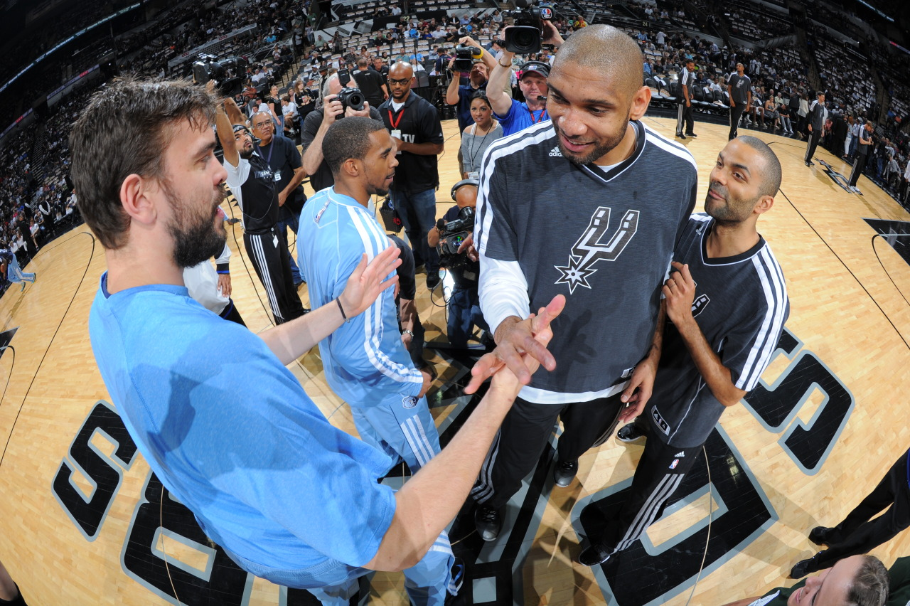 nba:  Tim Duncan of the San Antonio Spurs greets Marc Gasol of the Memphis Grizzlies during Game One of the Western Conference Finals between the Memphis Grizzlies and the San Antonio Spurs during the 2013 NBA Playoffs on May 19, 2013 at the AT&T Center in San Antonio, Texas.  (Photo by Andrew D. Bernstein/NBAE via Getty Images)
