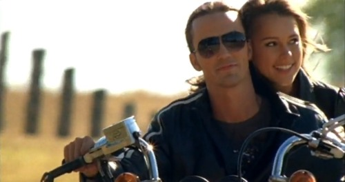 """She holds tight to me and the Bible On the back seat of my motorcycle""   Toby Keith - God Love Her"