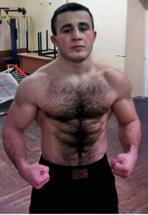 Young guy showing off his hairy body and muscles.