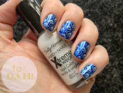 My first attempt at nail stamping! Konad plate M83 using Essie Aruba Blue and Sally Hansen White On polishes.