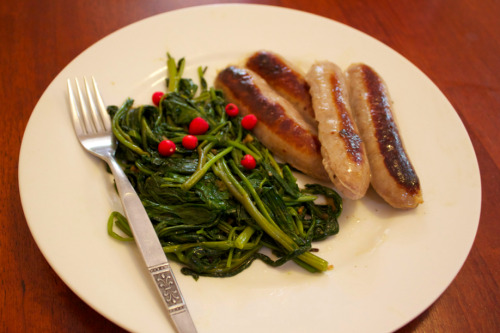 Kakadu plum pork sausages, kangkong sauteed with garlic, lilly pilly berries