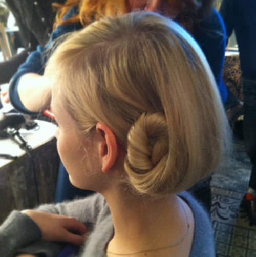 The gorgeous hair at Tory Burch had a deep part and was twisted behind the head into the spiral side bun. Photographed by Lauren Drago