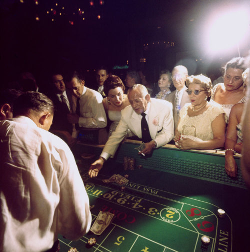 "vintagelasvegas:  Las Vegas 1955 from Life Magazine: ""Crap tables at Dunes were tried by Jake Freedman (center), owner of rival Sands club. He lost $10,000 before deciding his luck was off that night."" 