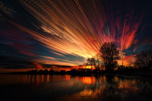 matt-molloy:  186 photos of the sunset merged into one image using the lighten layer-blending mode in photoshop. I like the pattern in the clouds created from the interval between shots.