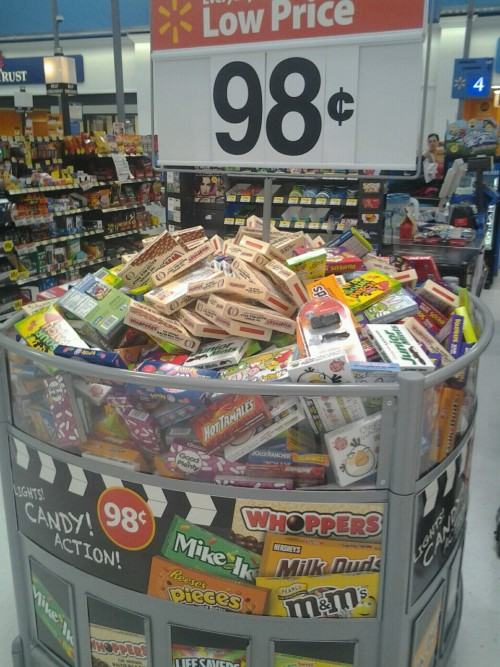 "miss-operator:  This stand of candy was placed right before the checkout lane. You can see behind it the other rows of candies, and other various junk foods.Yet our government ""wages war on obesity"" This strategically placed candy is even boldy advertised at the amazing price of 98cents! Now yes this store has every right to place their candy where they please, and charge what they please.  FREE Market however, THAT'S MY POINT. Do you not see what is happening? You're being baited and fattened like pigs to the slaughter, just so our government can make money and keep our population under control. Honestly, all of the blame can't really be on the government. People who fall for this stuff and become obese and get diabetes or heart diseases are only being thrown through the process of survival of the fittest. Think about it, free market allows people to kill themselves, and keep the population low. If the government controlled food and what people ate, the majority of people would be healthy and our population would be much much higher. Yearly, more than 300,000 people die from obesity and obesity related illnesses.  Our government mentions what they do to fight obesity a lot, yet McDonald's everywhere are replacing jungle gyms with video game stations, Grocery stores are baiting people with cheap shit food, and it's becoming more and more popular to use the ""easy way"" to weight loss. (sensa, diet pills, anorexia, bulimia). This is bullshit. WAKE UP PEOPLE."