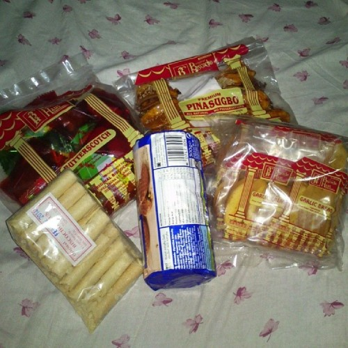 From iloilo with LOVE. #pasalubongfromtoto. :) #butterscotch #pinasugbo #garlictoast #barquillos. @johumje . :) ty ty.