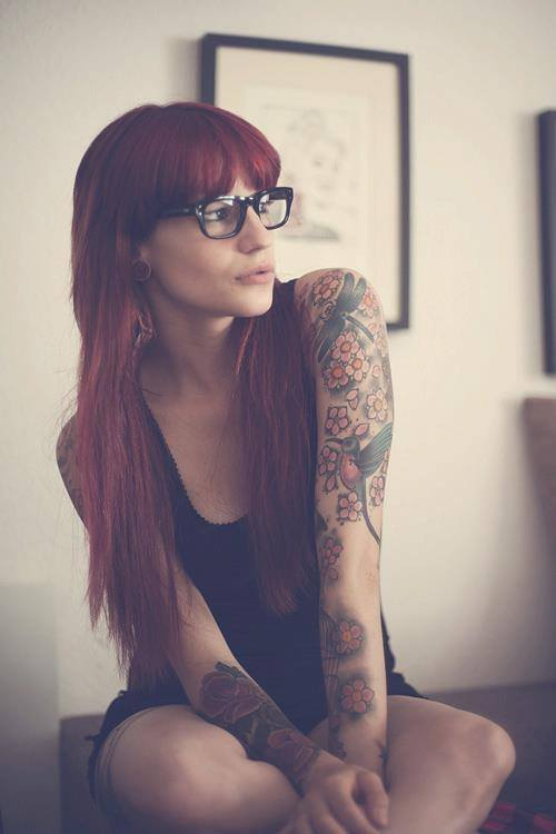legitcars:  praisethel0wered:  I'm a sucker for chicks with red hair and tattoos  I'm exactly the same way. Those glasses make her look sexier