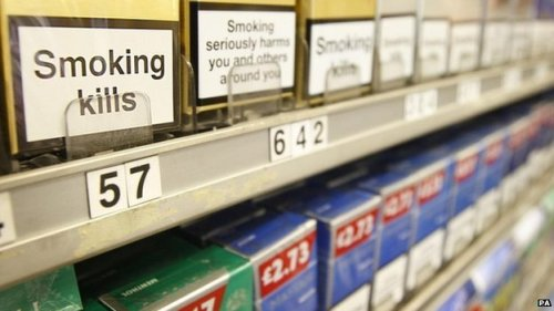 Tobacco display ban in large shops comes into force Cigarettes can no longer be displayed in Scottish shops   A ban on the display of cigarettes and other tobacco products in large shops in Scotland has come into force.  Public Health Minister Michael Matheson said the move will help prevent young people from taking up smoking.  Under the Tobacco and Primary Medical Services (Scotland) Act 2010, the sale of cigarettes from vending machines is also banned.  Stores that do not comply could be convicted of a criminal offence or receive a fixed penalty fine.  England, Wales and Northern Ireland have already brought in similar bans to prevent large stores from displaying cigarettes and tobacco.  The Scottish government's Tobacco Control Strategy also supports the introduction of standardised packaging. (From BBC)